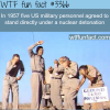 five men standing under a nuclear detonation